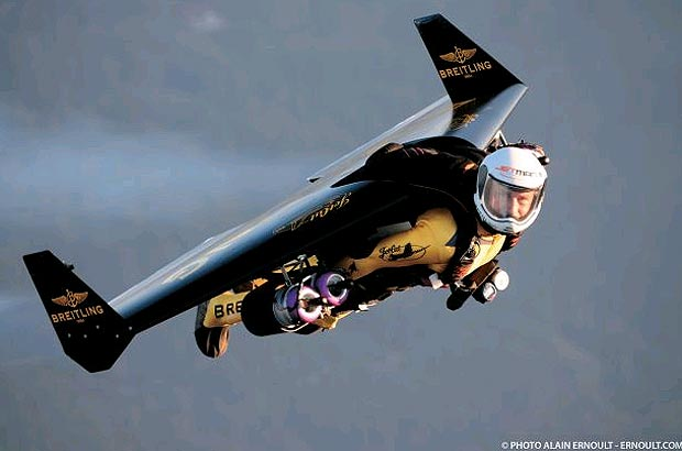 Jetman Yves Rossy flies with the Breitling Jet Team over the Grand Canyon