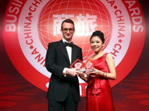 Cathay Pacific General Manager China Sam Swire (left) receiving two awards - Best Asian Airline Serving China and the Best Airline First Class - from Yun Zhang