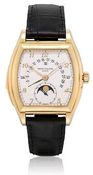 PATEK PHILIPPE, REF. 5013. AN EXTREMELY FINE AND RARE 18K GOLD TONNEAU-SHAPED AUTOMATIC MINUTE REPEATING PERPETUAL CALENDAR WRISTWATCH WITH MOON PHASES AND RETROGRADE DATE, MANUFACTURED IN 1993.