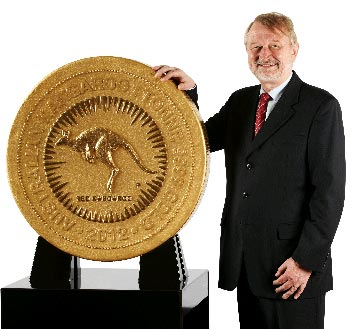 Perth Mint Chief Executive Officer, Ed Harbuz, presents the largest coin in the world – the 2012 Australian Kangaroo One Tonne Gold Coin.