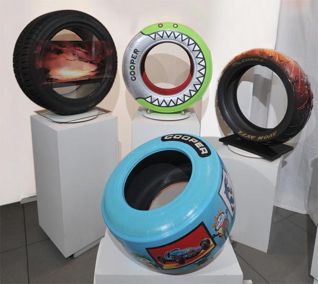 Four British Artists change road and race tyres into art for Castle Galleries.