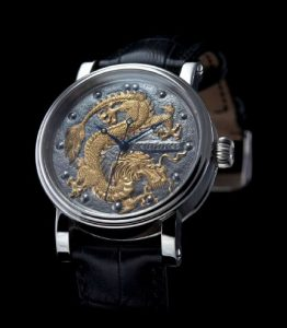 The Kudoke Golden Dragon watch with sterling silver dial and diamond eyes.