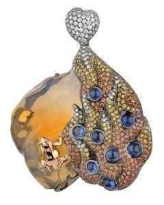 18K White Gold Pendant: 1 Opal – 23.848 carat, 8 Blue Sapphires – 3.546 carat, 201 Orange Sapphires – 3.62 carat, 68 Round Diamonds – 0.41 carat, 23.60 grams