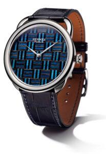 The House of Hermès introduce the Arceau Marqueterie de Paille watch.