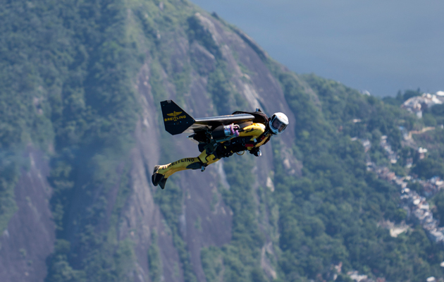 Jetman Yves Rossy soars over the City of Rio de Janeiro in Brazil