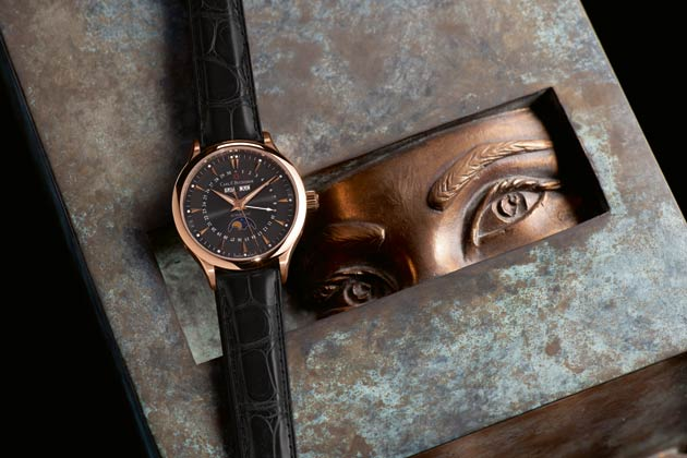 The Carl F Bucherer Manero MoonPhase wrist watch in rose gold.