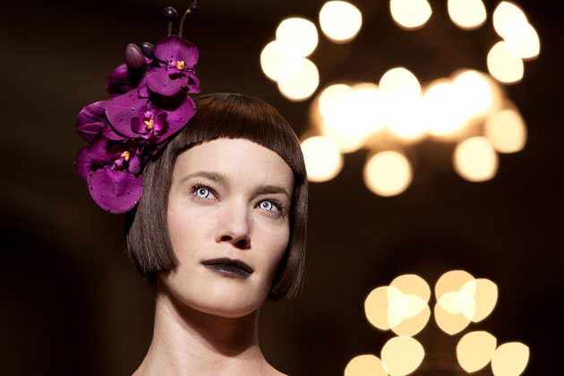 Hats by Philip Treacy compliments as a final touch to Didit Hediprasetyo's silhouette of the fall/winter 2012 collection.
