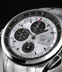 The Hamilton Khaki X-Patrol acts as a portable cockpit for navigating lifestyles. It provides conversions for distances in miles (nautical or statute) and kilometers, heights or altitudes in feet or meters, volumes in gallons and liters, as well as weights in pounds and kilograms, using a turning bezel. Conversions are simple to make, through unscrewing the easy-to-grip crown at 9 o'clock and positioning an arrow for the first unit of measurement on the outer bezel scale.