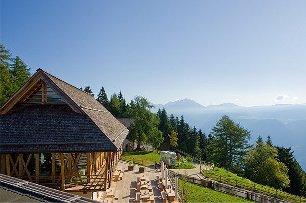 The vigilius mountain resort in South Tyrol is situated on the flanks of the Vigiljoch, Lana's landmark peak. The hotel's ecological commitment is evident in the use of natural construction methods and sustainable local resources including the grass-covered roof, 300-year-old timber beams in Restaurant 1500, and internally heated clay walls in the 41 rooms and suites.