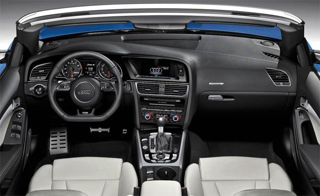 Inside, the cabin also features the latest RS 5 detail enhancements, including a new flat-bottomed RS three-spoke steering wheel, along with the new generation Coupe's equipment upgrade, which brings Bluetooth mobile phone preparation, cruise control, satellite navigation and Audi Music Interface iPod connection to the already lengthy standard equipment list.