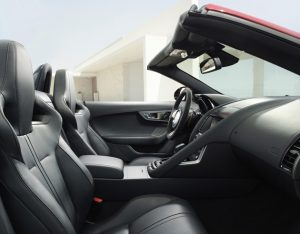 The focus on driver involvement and sporting performance in the F-TYPE is emphasised by the 'one plus one' layout of the asymmetric cabin. This is evidenced by the grab handle which sweeps down the centre console on the passenger side, delineating it from the driver's position. Further differentiation is provided by the use of different trim materials either side of the cabin, with a more technical finish on the driver's side.