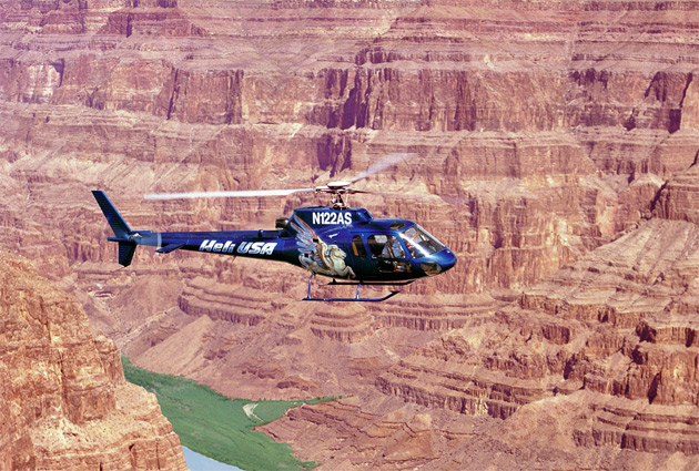 Grand Canyon Chariot of Fire Helicopter Flight from $379 per person. Experience the new helicopters with an extensive flight below the rim of the Grand Canyon. Guests are collected from their hotels and taken to McCarran Airport where they will board the helicopter for a trip of a lifetime. Highlights include the Hoover Dam, Lake Mead and the Canyon, throughout the flight, the pilot delivers a running commentary to explain the sights unfolding beneath, such as Eagle Rock, Guano Point and Thunderbird Mountain. Once back in Vegas airspace, the tour concludes with a spectacular flight down the world famous Strip.