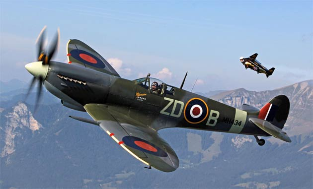 "As part of a celebration of Aviation, Yves ""Jetman"" Rossy took to the skies with fellow ""Breitling Flyer"" pilot, Nigel Lamb in the renowned Spitfire MH434."