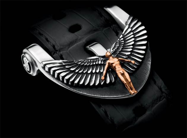 The Angelus' sculpted case comes alive with detail. Feathers wrap themselves around the crown, a symbol reprised for the lugs. The sides of the case are adorned with reclining angels, and another crouched angel with wings spread. Protected by a sapphire crystal, the white or iridescent mother-of-pearl dial contrasts with the Roman numerals and gilded, polished hands.