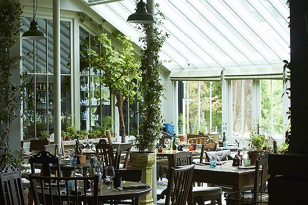 The central dining area is within a stunning vine-clad Victorian-style greenhouse, where the focus is on fantastic, uncomplicated and simple British garden food