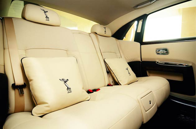 """To celebrate a decade of representing Rolls-Royce Motor Cars, Eurokars Group have commissioned a Singapore-edition Bespoke Ghost Extended Wheelbase. This exclusive car features Bespoke headrests and cushions embroidered with the iconic Spirit of Ecstasy and Bespoke treadplates that read """"10 Years of Rolls-Royce Motor Cars in Singapore"""
