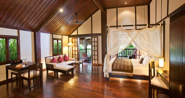 Eight rooms are located in The Khamboua House, a jewel of traditional Lao architecture. Built in 1903, it opens onto a beautiful 500-square-metre garden edging the Nam Khan River.