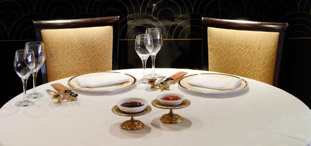 The restaurant's décor is similar to the flagship Royal China Club located just down the road, boasting sleek black lacquer and gold decoration throughout the vast dining room which is concentrated into one main space.