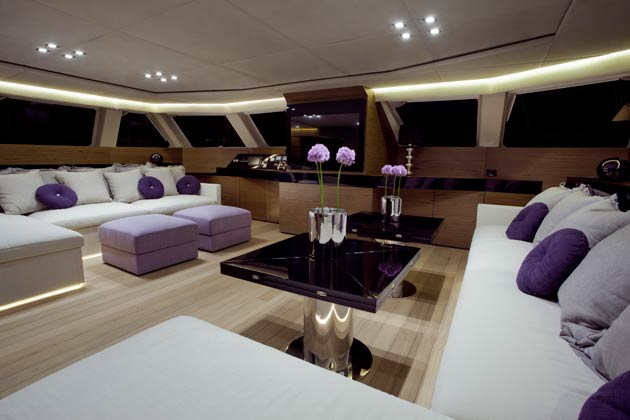 Inside the main deck there is a spacious saloon with comfortable sofas and a dining area for eight individuals with two coffee tables which can be converted into one big dining table