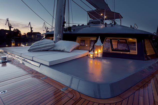 The light and dark grey of the hulls and superstructure with an all teak wet deck and flush hatches are a stylish combination that draws the attention of everyone around