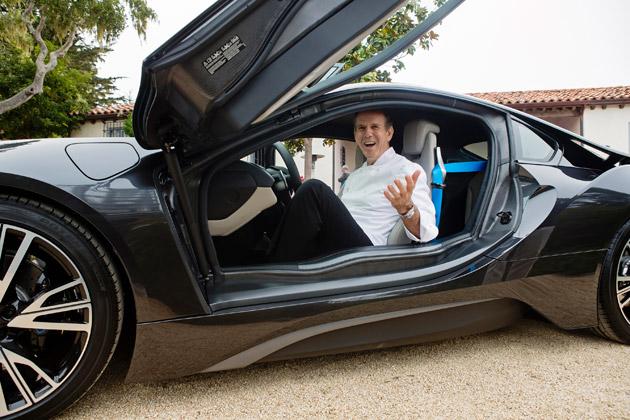 Chef Thomas Keller with his new BMW i8 at Pebble beach