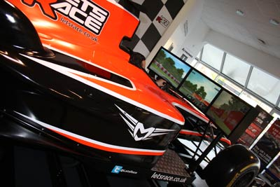 Paul Kinsley tests his driving skills in the Lets Race full motion F1 simulator