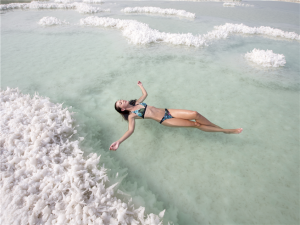 Floating at the Dead Sea​. Photographer: Itamar Grinberg for thinkisrael.com