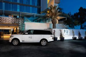 The chauffeur-driven ME by Meliá-branded white Range Rover
