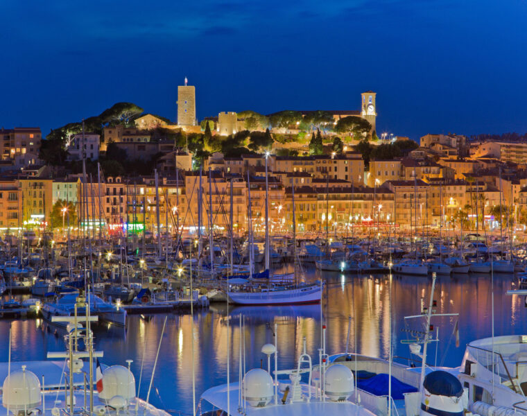 A Luxury Weekend Break On The Fabulous French Riviera: Image shows yachts moored at Cannes harbour at night. Atout France/Robert Palomba