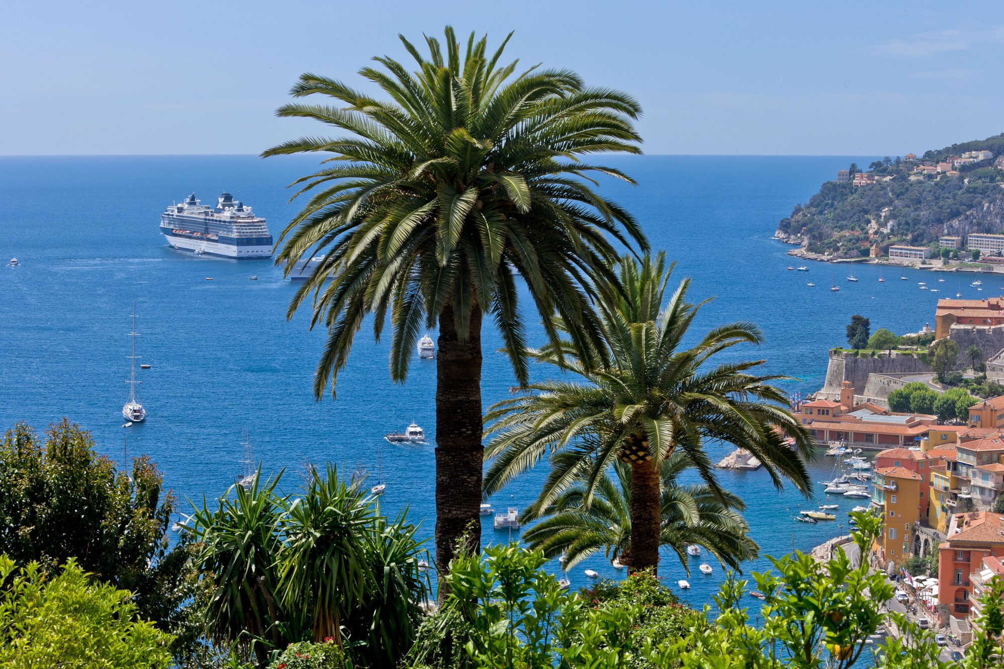 Image shows Villefranche-sur-Mer on the shores of the Mediterranean, with its cruise ships and pleasure boats. Atout France/Robert Palomba