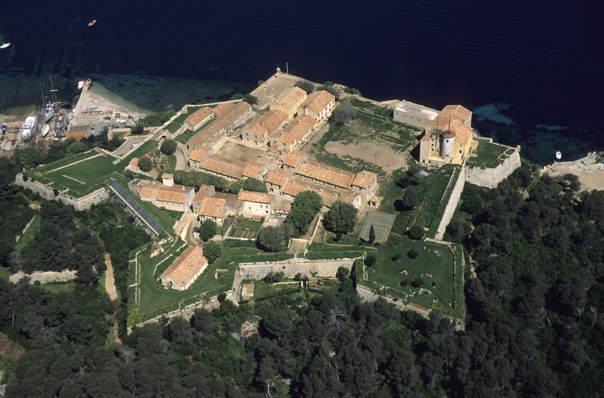 "Image shows Aerial view of the Royal fort on the island of Sainte-Marguerite in the LØrins Islands archipelago, facing Cannes. Designed by Vauban in the late 17th century, the fort was used as a Government prison including the famous ""Man in the Iron Mask"". Atout France/Emmanuel Valentin"