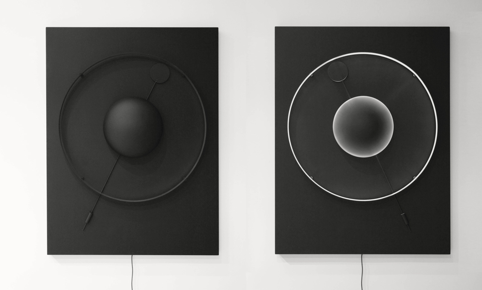 """""""Circular Variations"""" is an illuminated ring phasing in and out as a pendulum rocks steadily from one side to the other, images of rings around planetary orbs come to mind."""