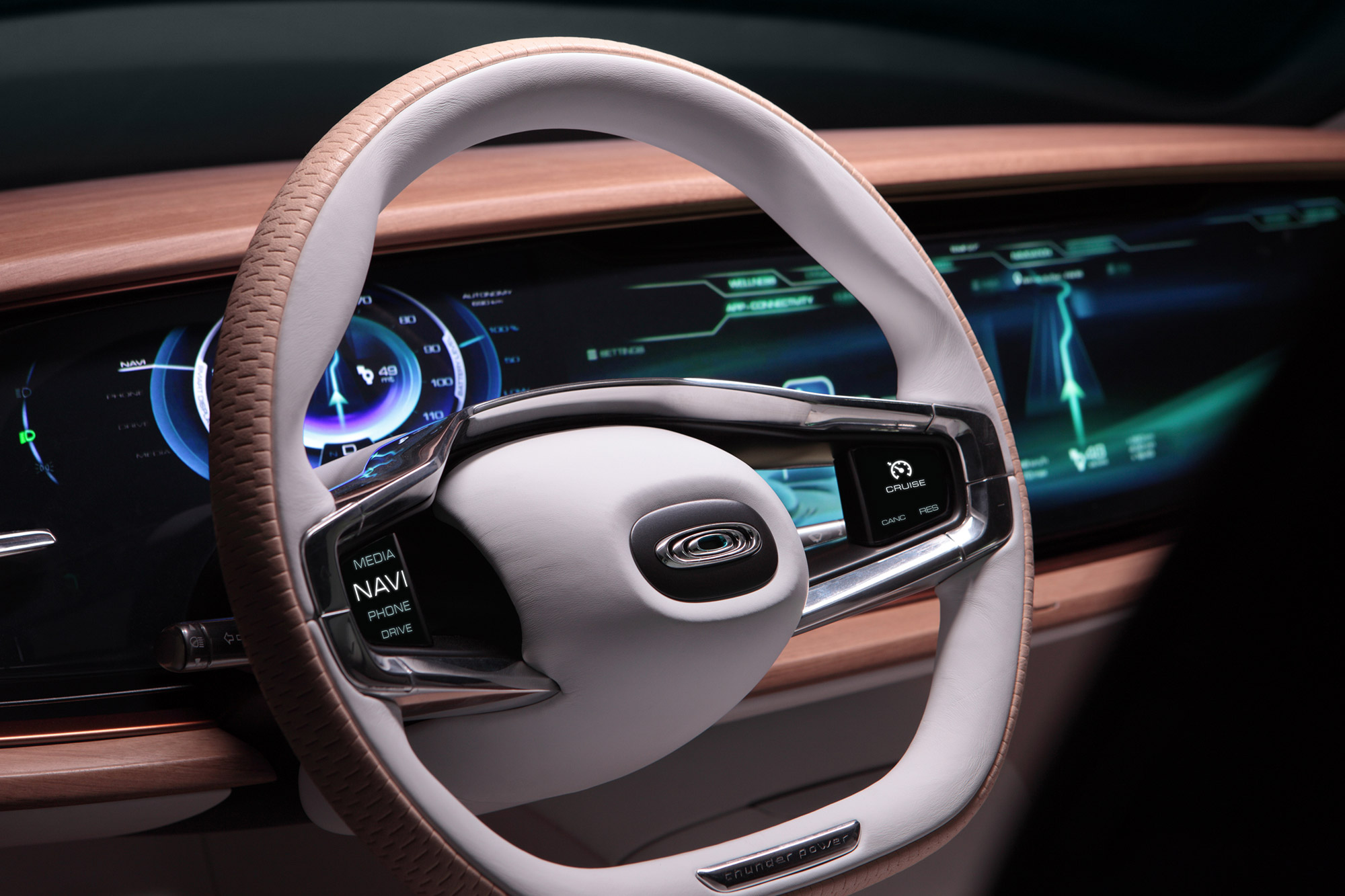 The interior looks very good and the cigar-shaped LED console with it's touch screen capability looks packed to the rafters with the latest technology