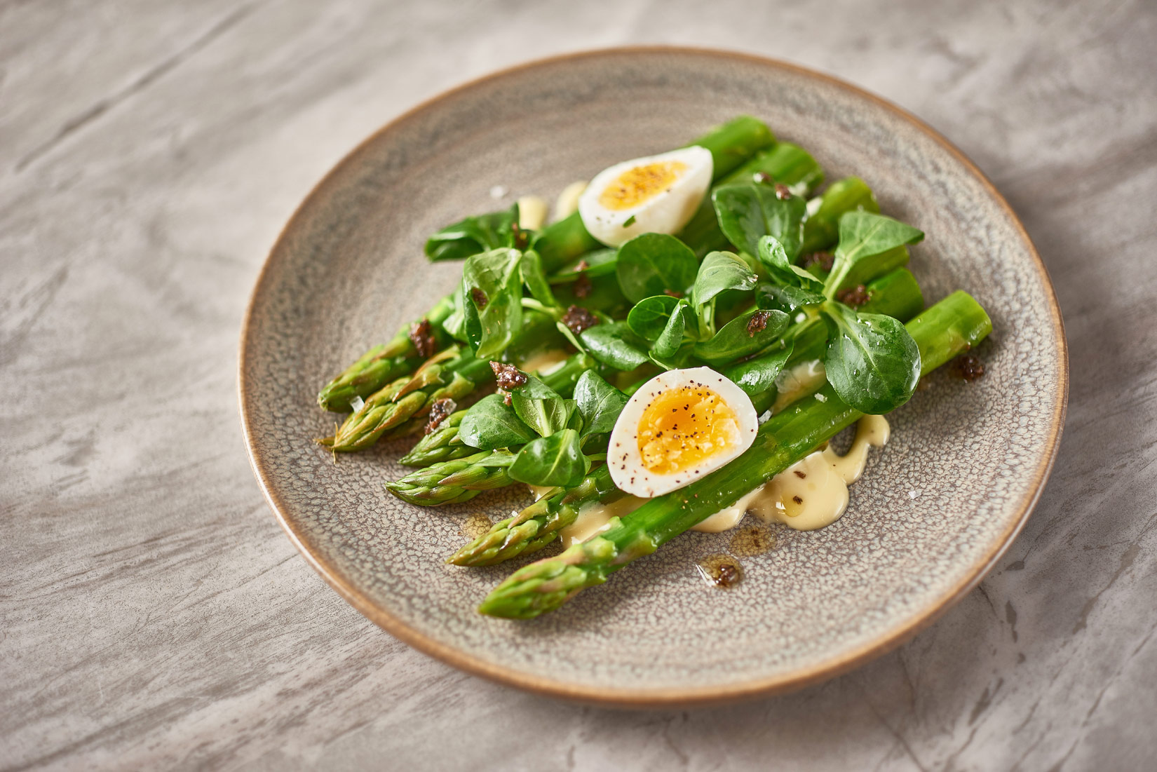 Asparagus with sliced pheasant egg at Toms Kitchen in Chelsea