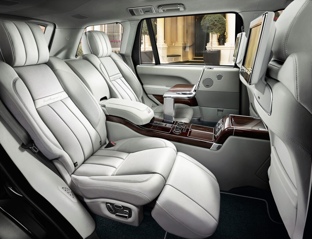 The luxurious rear seat section showing the seats in a reclined position and the large central divider