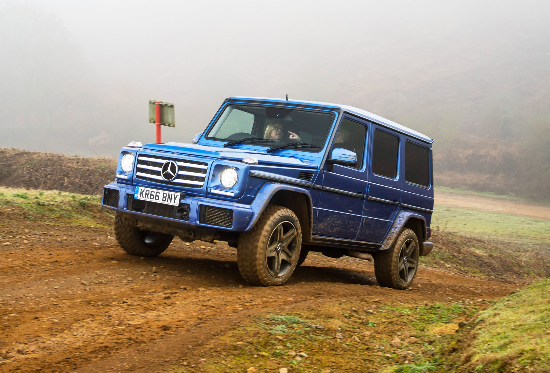 Gina behind the wheel of the Mercedes-Benz G350 D at Millbrook