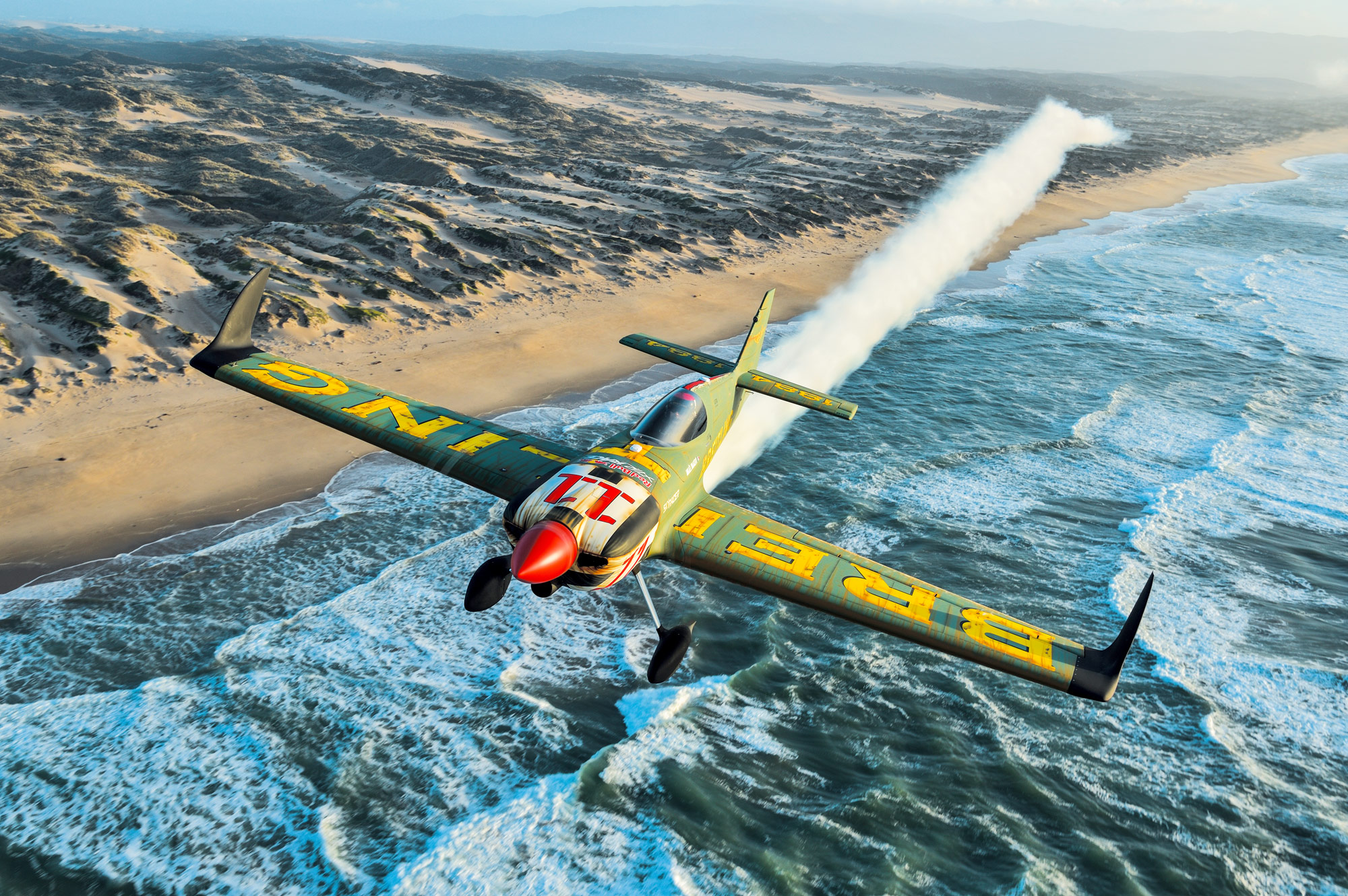 Mika Brageot And His 'Skyracer' Flying Under The Breitling Colours