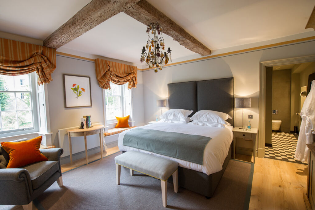 The beautiful and large cottage themed bedroom at Thyme in the Cotswolds