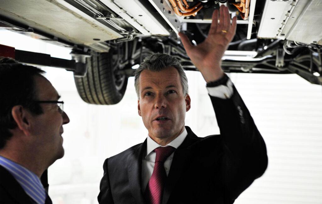 Torsten Müller-Ötvös Chief Executive, Rolls-Royce Motor Cars inspecting one of their cars