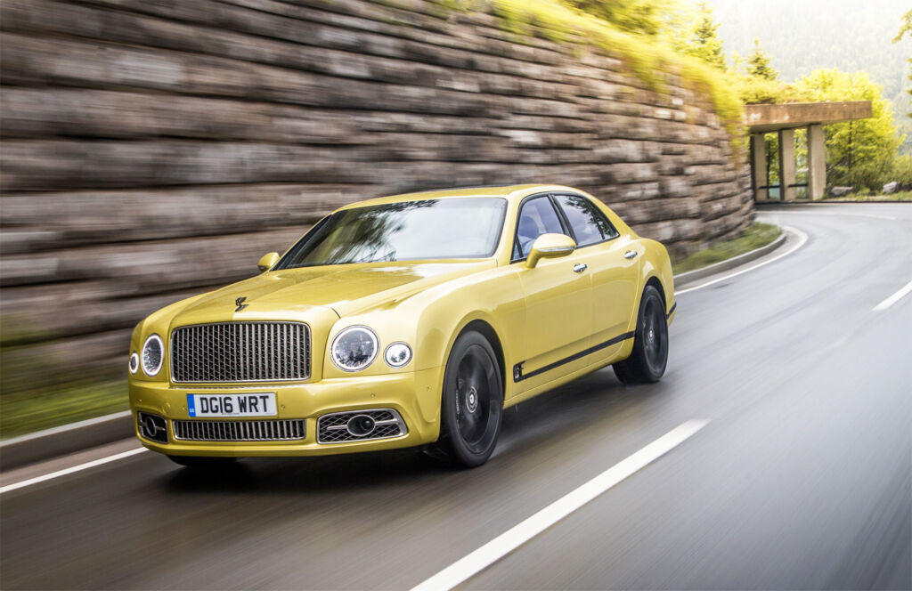 Mustard coloured Mulsanne driving at speed
