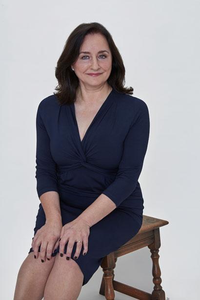 Photograph of Award-Winning Designer, Tina Malhamé seated