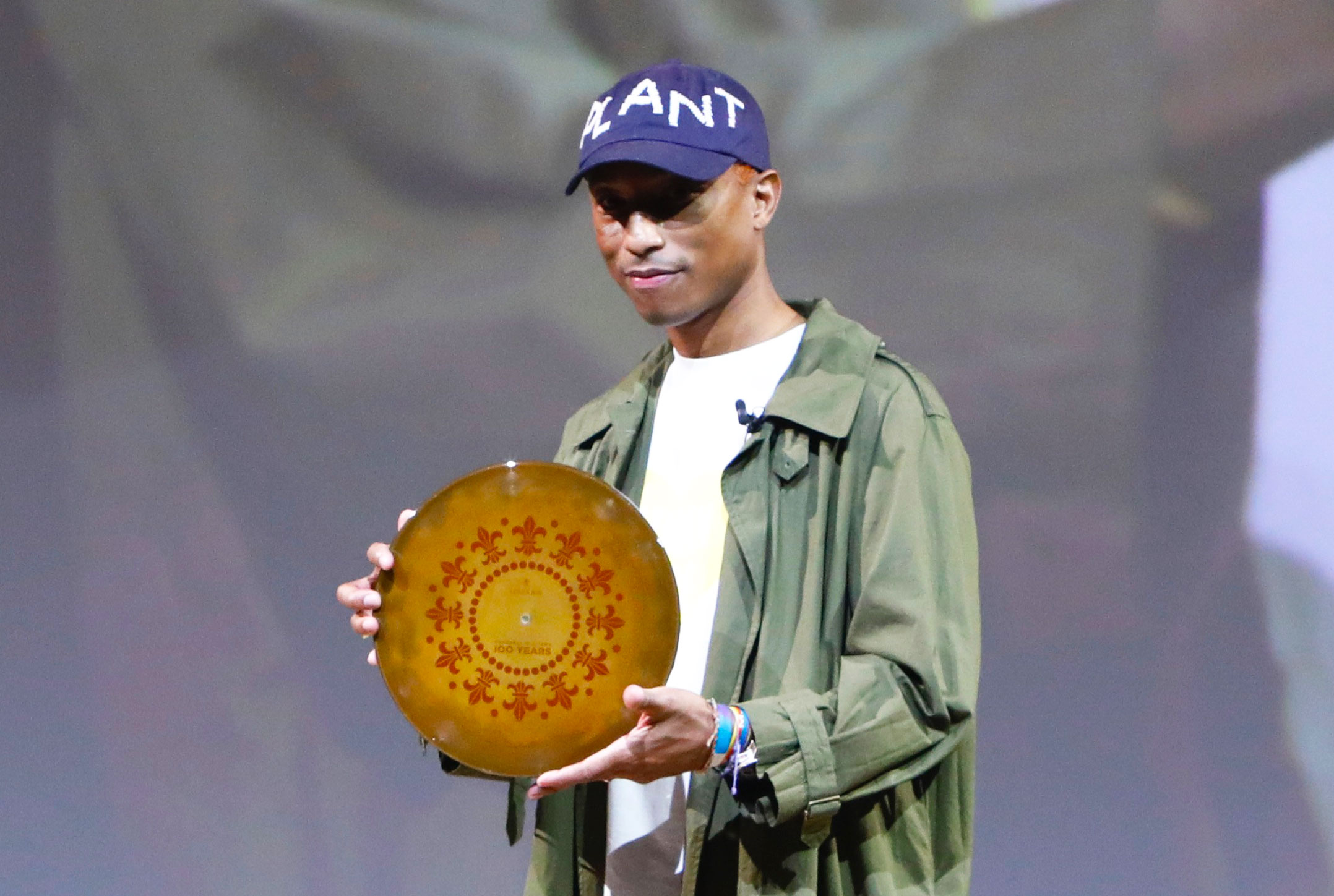Pharrell Williams holding 100 years