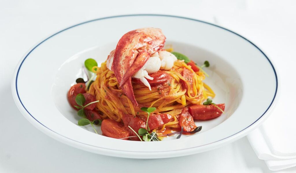 A spaghetti dish with the meat from a lobster claw