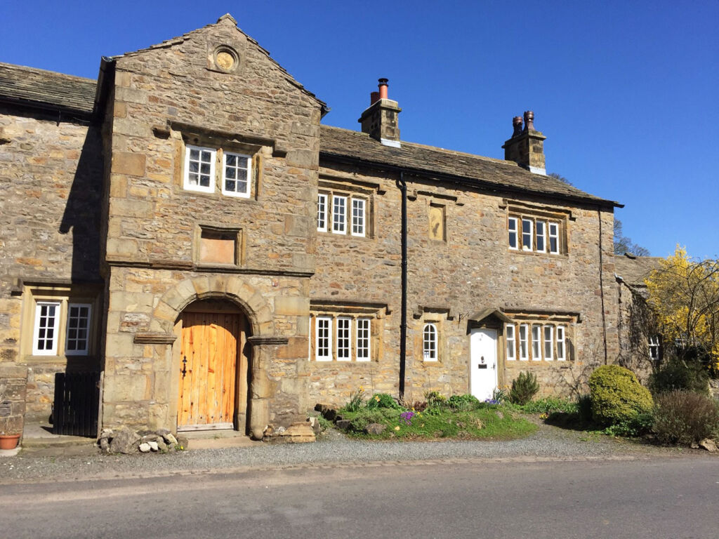 Stone built cottage in the centre of Downham village in Lancashire