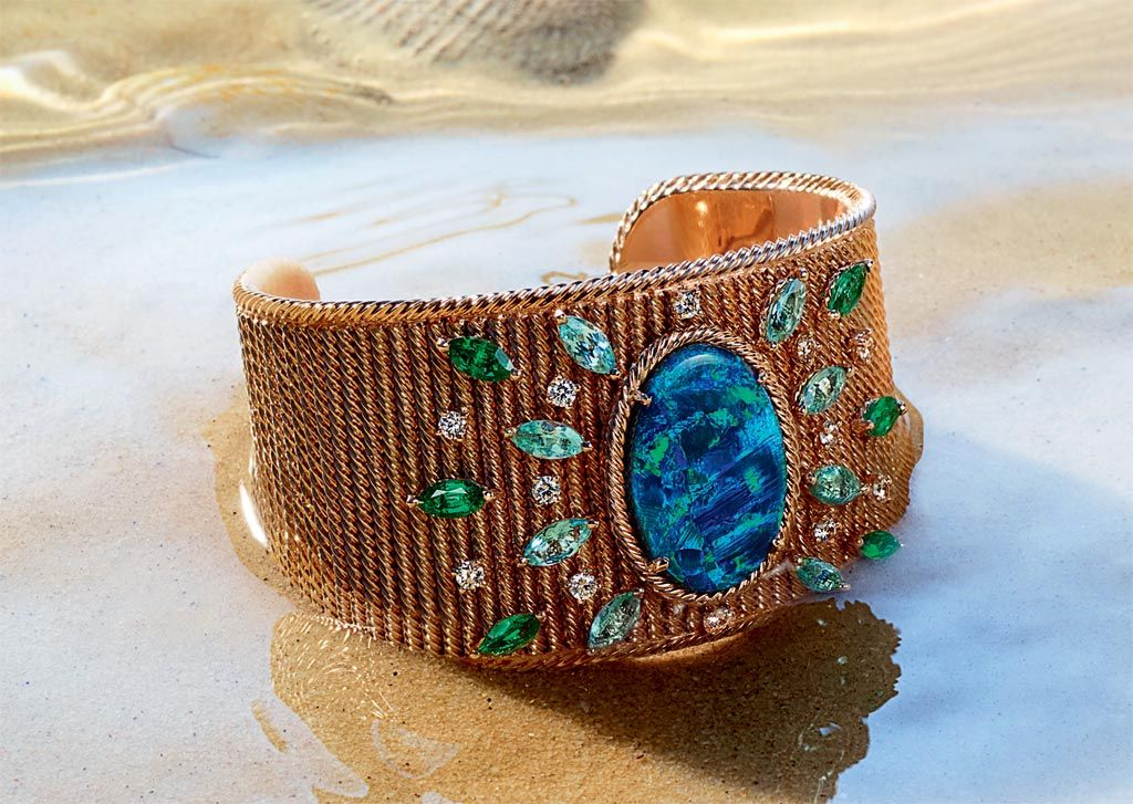 A cuff bracelet with large opal from the Piaget Manchette Story