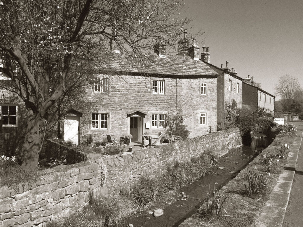 Black and white photo of a cottage in Downham