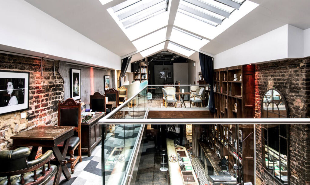 The mezzanine level at the LIBRARY Private Members' Club in London.