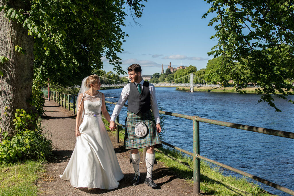 Newly married couple by the River Ness