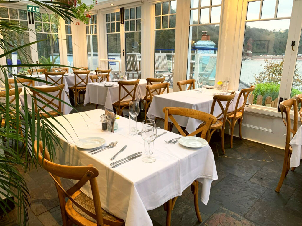 The Cary Arms restaurant conservatory with its far-reaching views.