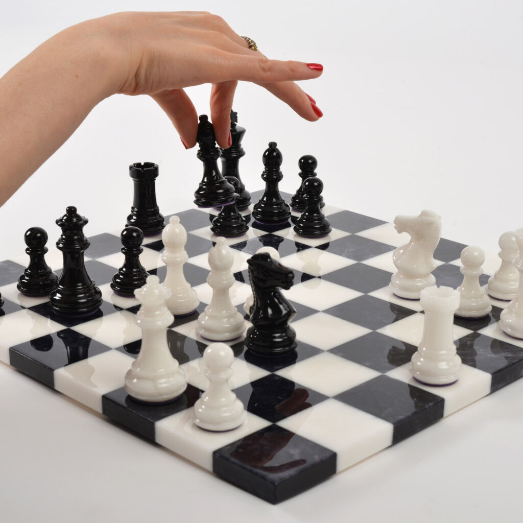 Stone Chess White v Black pieces in play with hand